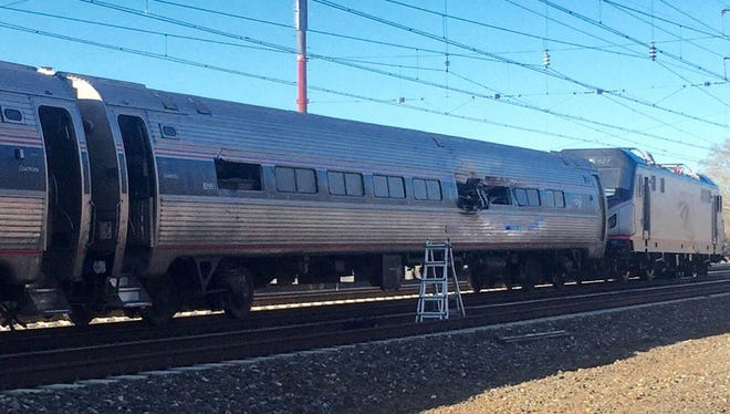 An Amtrak train is shown after a crash Sunday in Chester, Pa. Amtrak said the train was heading from New York to Savannah, Ga., when it struck a backhoe outside of Philadelphia.