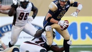 Winnipeg quarterback Drew Willy (5) is sacked by Ottawa's Jonathan Williams (75) during the first half of a CFL game action on July 3. (AP Photo/The Canadian Press, John Woods)