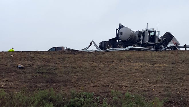 An 18-wheeler and pieces of the guard rail rest on the edge of the Interstate 20 Tuesday Sept. 26, 2017, about two miles east of Sweetwater on the westbound side. A second tractor-trailer was also involved with traffic being diverted around the accident.