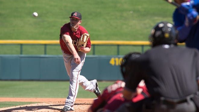 """Diamondbacks pitcher Addison Reed throws a pitch on March 24, 2015, in the """"B"""" game at Sloan Park in Mesa."""
