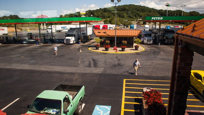 Truck drivers make their way into White's Travel Center in Raphine on Tuesday, Sept. 8, 2015.