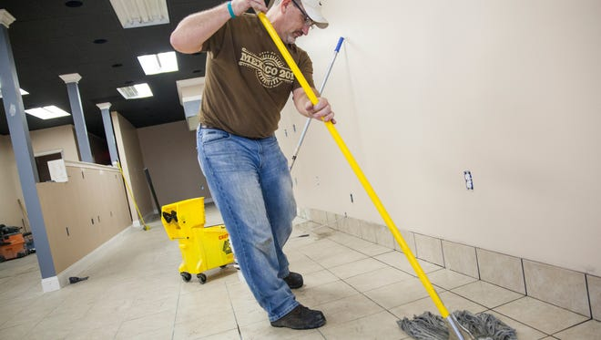 Greg Mayo, senior pastor at Cornerstone Church of Augusta, cleans the under-construction Gateway Cafe in Fishersville on Tuesday, Oct. 27, 2015. The cafe is being opened as a for-profit business with the church as the majority shareholder.