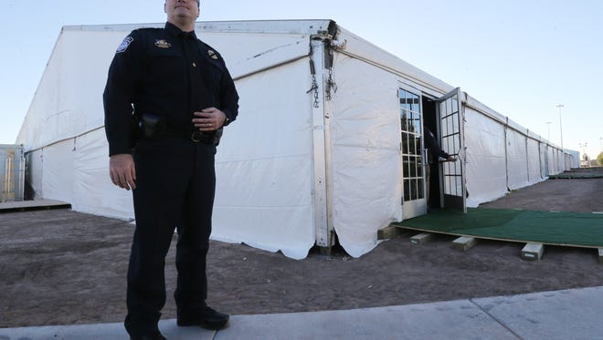 Samuel Cleaves is the commander of the temporary detention facility near Tornillo. The structure behind him includes an intake area and rooms for families.