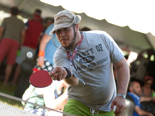 Jared Lamar plays ping pong in the Snake Pit on Sunday, May 25, 2014, at the Indianapolis Motor Speedway during the 98th running of the Indianapolis 500.