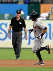 Tigers second baseman Ian Kinsler rounds the bases on his solo home run as second base umpire Angel Hernandez, rear, watches during the first inning on Wednesday, Aug. 16, 2017, in Arlington, Texas.