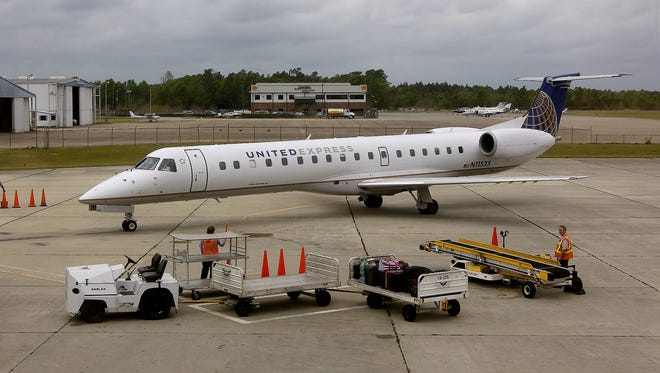 A United Express jet pulls toward the gate shortly after its arrival at the Mobile Regional Airport April 9, 2013, in Mobile, Ala.