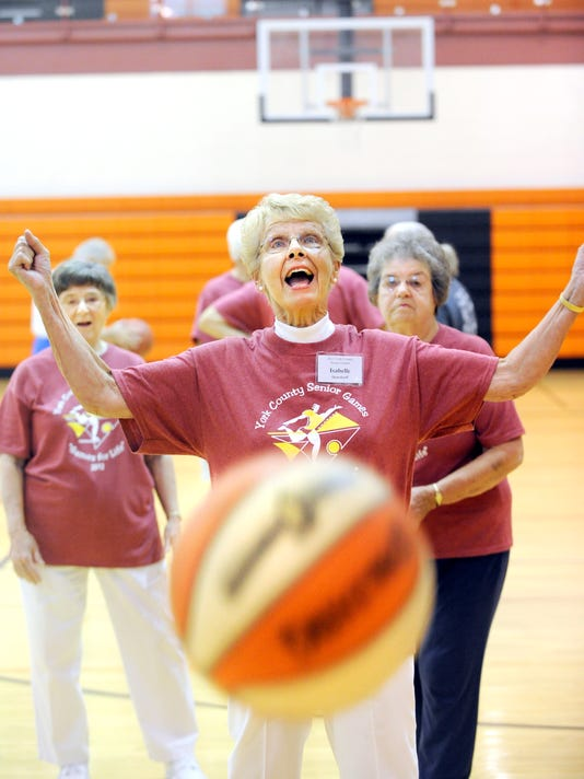 Isabelle Deardorff celebrates sinking a free throw while practicing for the basketball competition of the York County Senior Games in June 2012. Registration is open for the 2013 edition of the games. (Daily Record/Sunday News -- File)