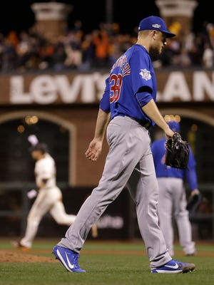 Chicago Cubs pitcher Mike Montgomery walks off the field after allowing a run-scoring double to San Francisco Giants' Joe Panik, rear left, during the 13th inning of Game 3 of baseball's National League Division Series in San Francisco, Monday, Oct. 10, 2016. The Giants won 6-5. (AP Photo/Ben Margot)