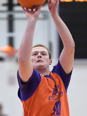 University of Evansville freshman Evan Kuhlman hoists up a shot during a three-point shooting contest at the HoopFest season tipoff for the men's and women's basketball programs at the Meeks Family Fieldhouse on Wednesday.