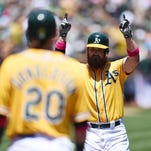 OAKLAND, CA - MAY 11:  Derek Norris #36 of the Oakland Athletics celebrates after hitting a three-run homer in the bottom of the first inning against the Washington Nationals at O.co Coliseum on May 11, 2014 in Oakland, California. The home run was Norris's first of two three-run homer in the first two innings.  (Photo by Thearon W. Henderson/Getty Images)