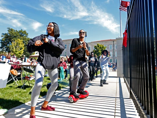 Missouri State University students (from left) Teasia Atwater, Jakobi Connor and other members of the Untamed Tongues poetry group dance prior to the start of the Bears' game against the Indiana State Sycamores at Robert W. Plaster Stadium in Springfield, Mo. on Oct. 3, 2015. Indiana State won the game 56-28.