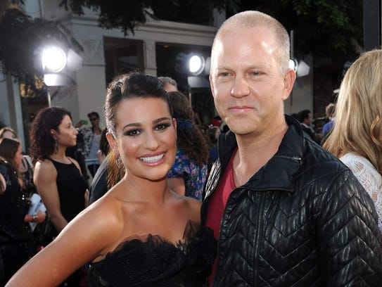 Lea Michele, left, and Ryan Murphy attend the 2011