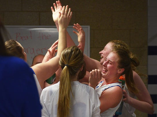 Warner celebrates their win against Sully Buttes in
