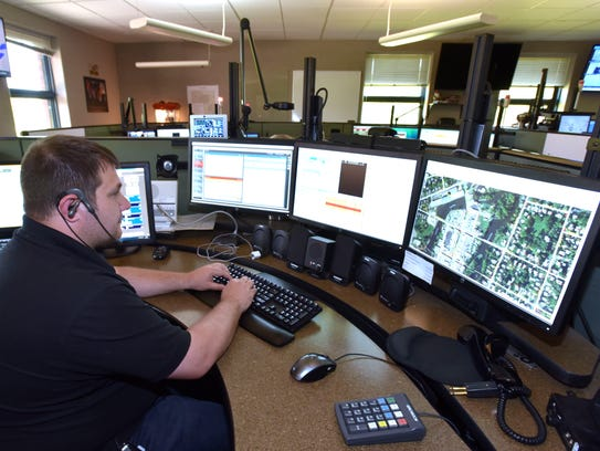 Eaton County 911 Dispatch Center supervisor and dispatcher Francis D'Huyvetter performs his duties.