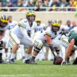 Michigan's QB battle features experience, but will there be progress?