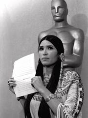 Sasheen Littlefeather holds up a statement that she read March 23, 1973, at the Academy Awards ceremony in Los Angeles on behalf of Marlon Brando, who declined to accept his Oscar as best actor to protest the treatment of Native Americans in television and movies.