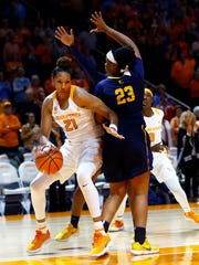 Tennessee center Mercedes Russell (21) drives past East Tennessee State forward Britney Snowden (23) during their game, Sunday, Nov. 12, 2017, in Knoxville, Tenn.
