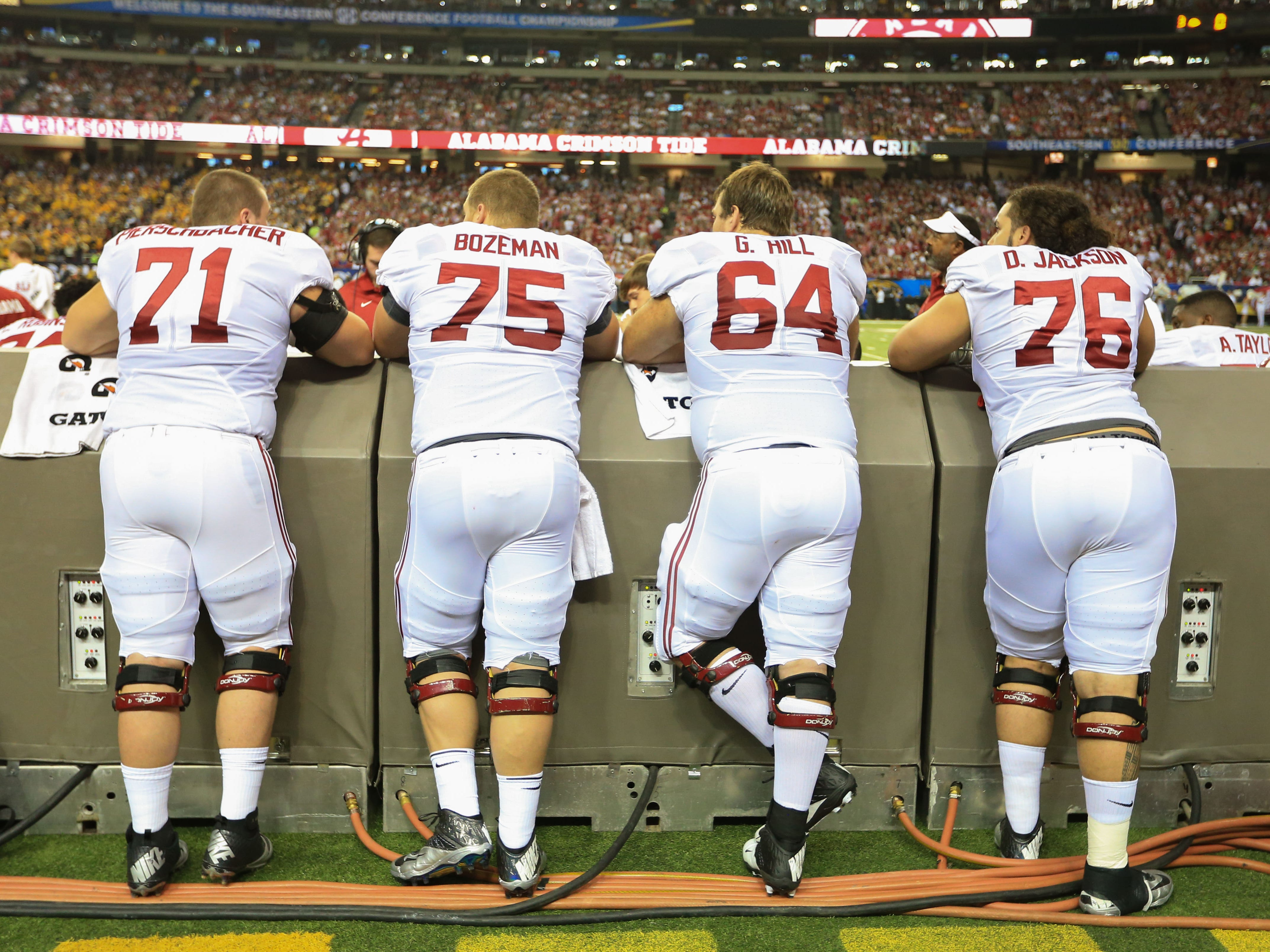 From left: Alabama offensive linemen Ross Pierschbacher, Bradley Bozeman, Grant Hill and Dominick Jackson watch the 2014 SEC Championship Game against Missouri. Jackson has the inside track on replacing Austin Shepherd at right tackle.