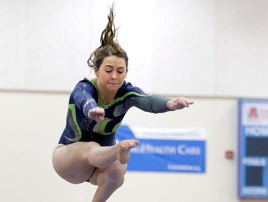 Whitefish Bay's Aly Yurkowitz competes on the beam