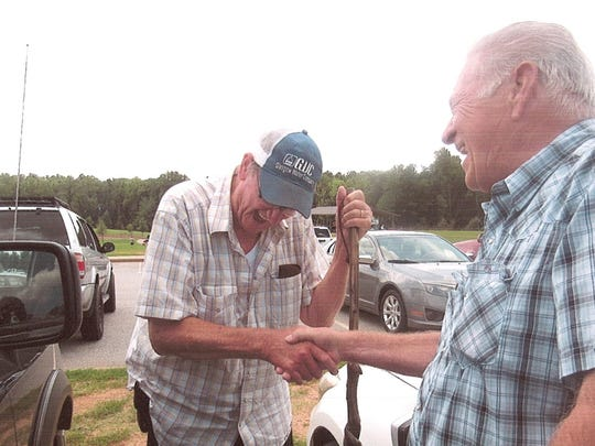 """Thomas Belue (left) and Carl """"Sonny"""" Payne reunited July 28, more than 50 years after the two served together in the U.S. Army. Belue and Payne frove trucks hauling supplies from the South China Sea into the mountains of Vietnam."""