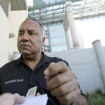 Sheriff Marlin Gusman speaks outside a new jail facility as buses transferring inmates from the old New Orleans jail arrive at the newly constructed facility in New Orleans, in September, 2015. Sheriff Gusman says the new building will be key to implementing needed reforms but the move comes as Gusman is under renewed criticism from the city and inmate advocates over a variety of issues arising from his stewardship of the lockup.