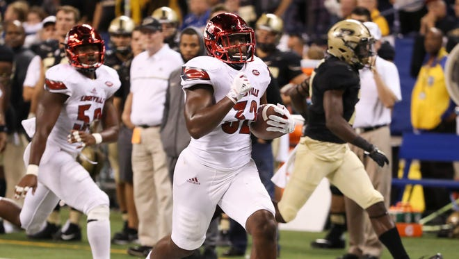 U of L's Stacy Thomas (32) returns the ball 61 yards to score after intercepting Purdue QB David Blough's (11) pass and then outrunning him to the end zone during their game at Lucas Oil Stadium in Indianapolis.Sep. 2, 2017