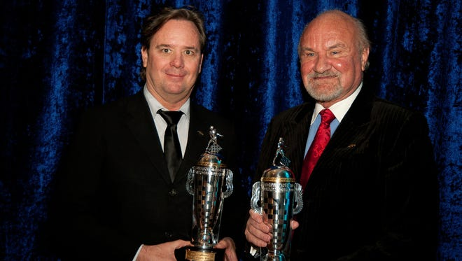 Team co-owners Jimmy Vasser, left, and Kevin Kalkhoven of KV Racing Technology accepted a BorgWarner Championship Team Owner's trophy for Tony Kanaan's victory in the 2013 Indy 500. The team is calling it quits.
