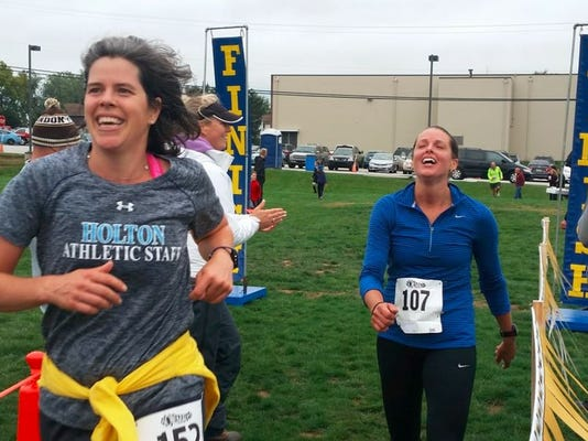Runners cross the finish line at the Hanover-area YMCA half marathon.