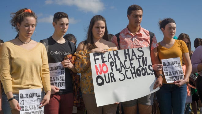 Students at Southern Regional High School in Stafford showed their solidarity with the Parkland Florida students by staging a walk out and a short reading about each of the 17 students killed followed by a minute of silence for each.