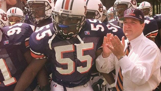 Former Auburn linebacker Takeo Spikes (55) will deliver the game ball to Saturday's Chick-fil-A Kickoff Game in Atlanta.