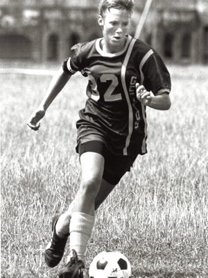 Kelly Hogan, a 17-year-old in this November 1990 photo, is one of the George Washington Geckos' most talented multi-sport athletes ever to rep the purple and gold. She excelled at everything in track and field and cross country, but on the pitch, Kelly Hogan was the queen of soccer. At 5-foot-8, 130 pounds, Hogan played better than many male soccer players.