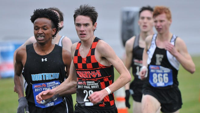 Brighton sophomore Zachary Stewart (29) is in a crowd at the finish line of the MHSAA Division 1 Boys Cross Country Finals Saturday, November 4th, 2017. He finished 15th.