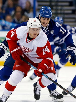 Detroit Red Wings' Gustav Nyquist (14), of Sweden, is pursued by Tampa Bay Lightning's Brian Boyle during the first period of an NHL hockey game Friday, March 20, 2015, in Tampa, Fla.