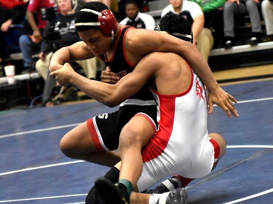 Jabari Thomas of Fairfield drops Casey Wiles of LaSalle