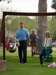 Mayor Greg Stanton and his wife, Nicole, play with their children.