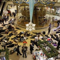 Protesters of the grand jury decision in the Michael Brown shooting chant slogans at Galleria mall on Wednesday in Richmond Heights, Mo.
