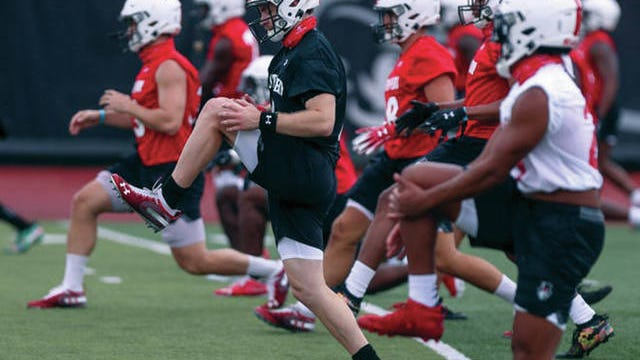 Austin Peay University quarterback Jeremiah Oatsvall, center, moves across the field during conditioning at Fortera Stadium in Clarksville.