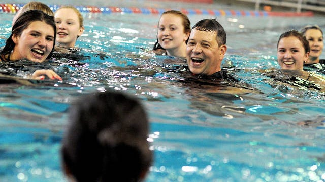 The Ames school district is looking into naming the new Ames High pool after longtime boys' and girls' swim coach Dan Flannery, who died of a brain aneurysm in late July. Ames Tribune File Photo.