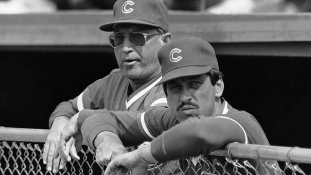 Jim Frey (left), who managed the Chicago Cubs for two-plus seasons after spending more than a season as manager of the Kansas City Royals, died Tuesday at his home in Ponte Vedra, Fla., at the age of 88. left and coach John Vukovich watch the team work in spring in Arizona at training camp.