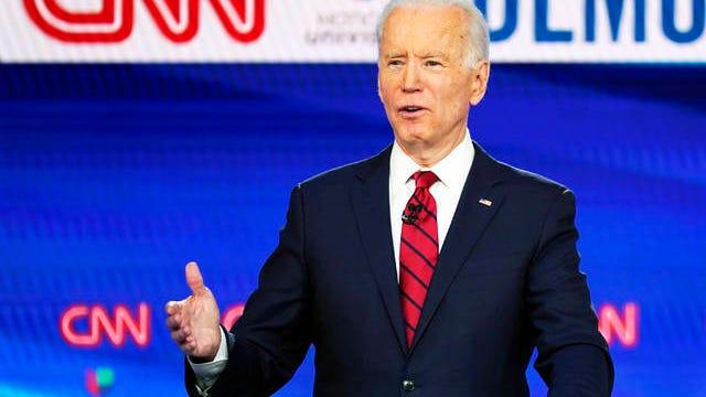 In this March 15 photo, former Vice President Joe Biden, with Sen. Bernie Sanders, I-Vt., speaks during a Democratic presidential primary debate at CNN Studios in Washington.