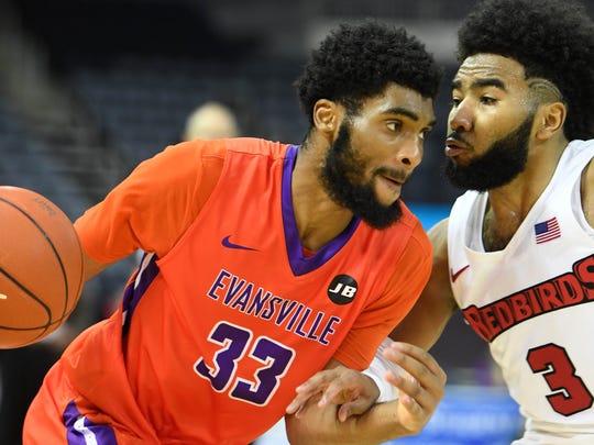 University of Evansville's K.J. Riley (33) drives against
