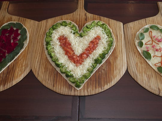 Heart-shaped pizzas come with various toppings at Forno Pizzeria in Maple Shade.