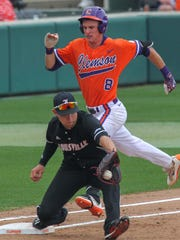 Clemson freshman shortstop Logan Davidson (8) tries to beat the play to Louisville first baseman Drew Ellis during the bottom of the third inning on Friday at Doug Kingsmore Stadium in Clemson.