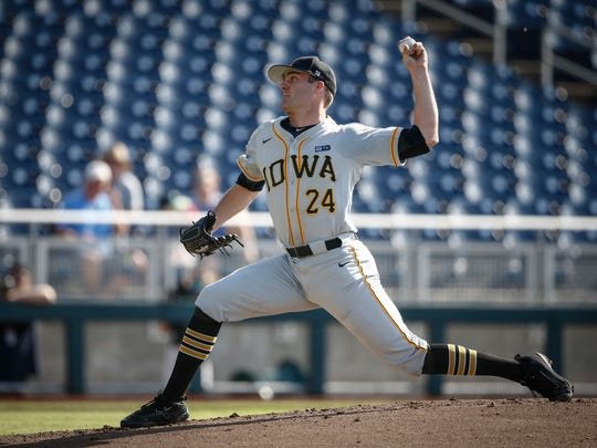 Iowa junior pitcher Nick Allgeyer fires a pitch against Michigan during the Big 10 Baseball Tournament on Wednesday, May 23, 2018, in Omaha, Neb.