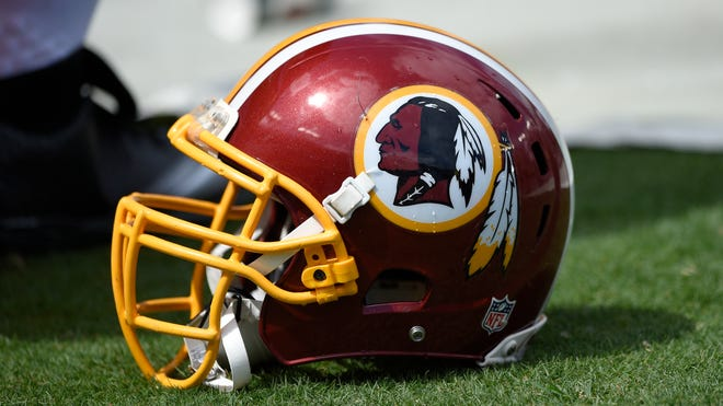 A Washington Redskins helmet is seen during the first half of an NFL football game against the Jacksonville Jaguars, Sunday, Sept. 14, 2014, in Landover, Md. (AP Photo/Nick Wass)