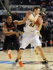 Iowa's Nicholas Baer fights for a rebound during the