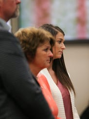 Lindsey Lemke, a former neighbor and patient of Larry Nassar, is accompanied by her mother, Christy Lemke-Akeo, as she makes a victim impact statement Jan. 16, 2018.