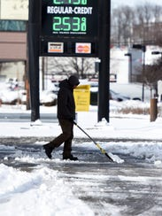 An employee of Enrite gas station shovels on Thursday