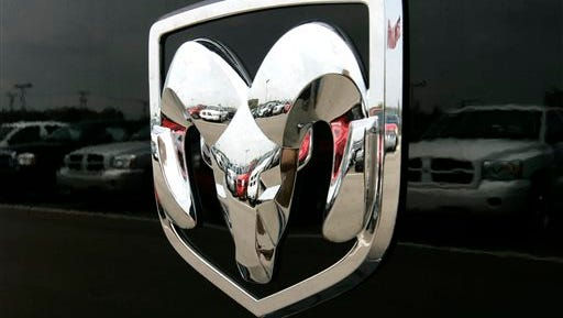 This file photo, shows the Dodge logo on a Ram pickup truck at a dealership in Bloomfield Hills, Mich. Chrysler is recalling nearly 257,000 older Ram 1500 pickup trucks from the 2005 model year because the rear axle can seize or the drive shaft can fall off.