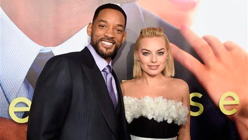 """Will Smith, left, and Margot Robbie arrive at the world premiere of """"Focus"""" at the TCL Chinese Theatre on Tuesday, Feb. 24, 2015, in Los Angeles. (Photo by Chris Pizzello/Invision/AP)"""